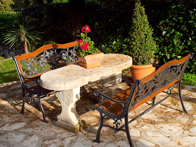 Garden with a hundred year old table made of stone